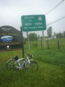 A bike near a Welcome to NY Sign